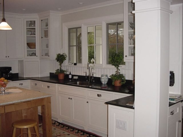 White kitchen cabinets with inset face frame