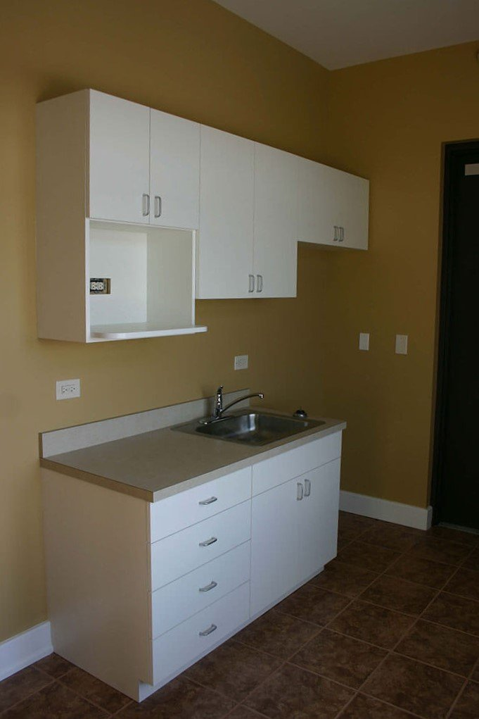 Breakroom with white laminate cabinetry