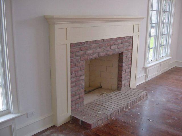 White shaker style fireplace mantel
