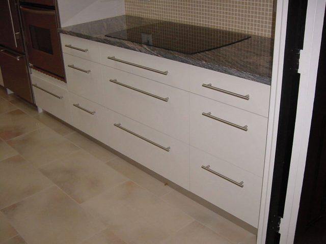 Kitchen with white slab doors