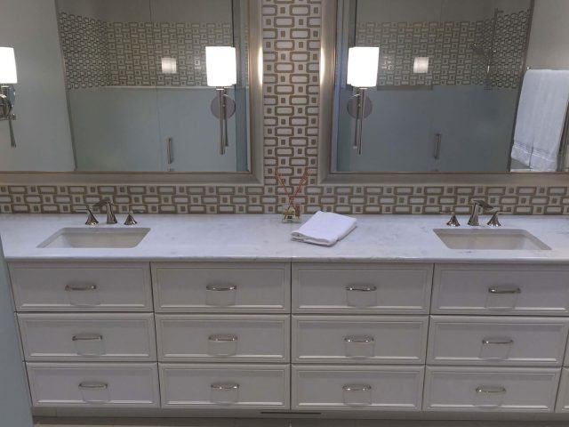 Front view of white bathroom vanity cabinets