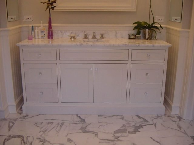 White vanity with inset face frame cabinets