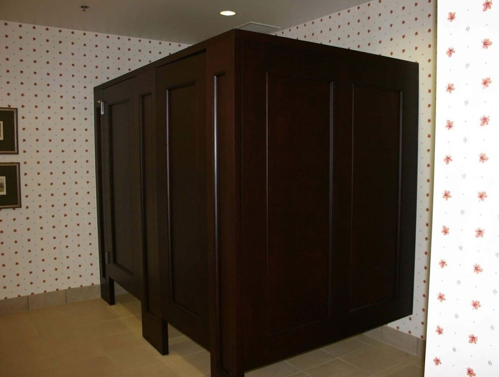 Commercial restroom with custom wood stalls